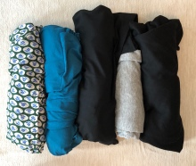 My 5 rolled up tops for 2.5 weeks - a silk patterned tunic, 2 knit tunics in teal and black, and 2 t-shirts, one grey, one black.