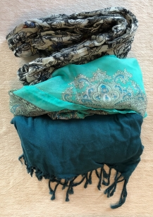 Being a scarf-lover, I couldn't travel without them. I'm taking one pashmina for cold weather, one silk scarf for dressing up and one cotton scarf for adding interest to everyday outfits.